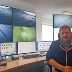 Picture: Mr. Espen Skjellhaug at the control centre for the two farms